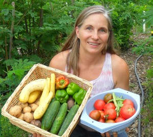 Marjory in garden holding veggies full 300x270 Meet the Experts